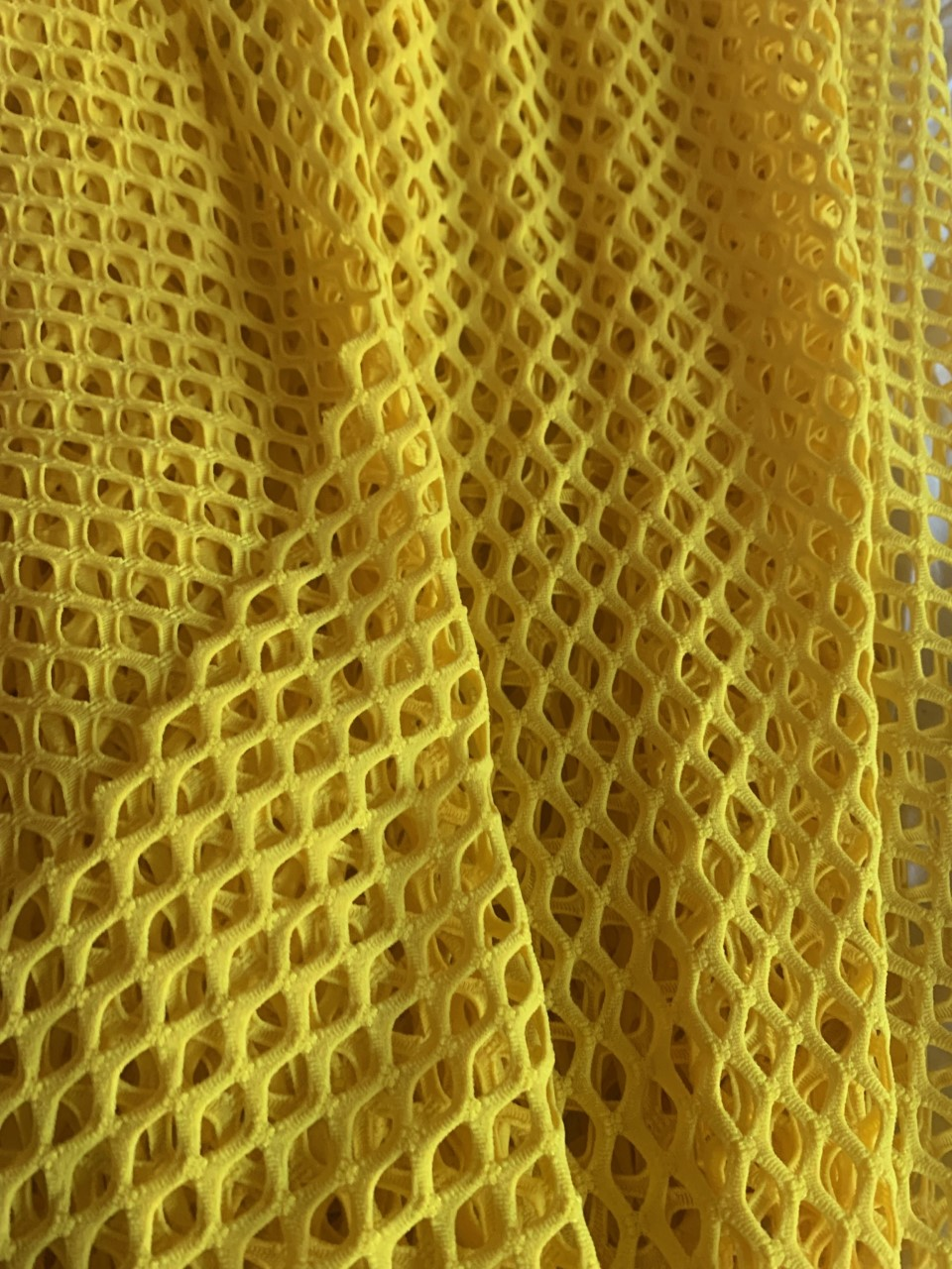 "58"" Yellow Poly Mesh Fabric BTY 75% Poly, 17% Nylon, 8% Spandex"